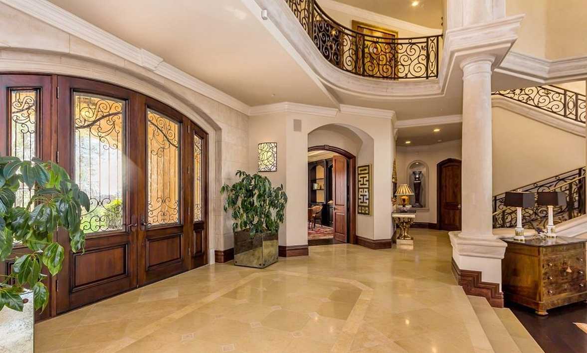 Mediterranean entryway with columns limestone tile floors crown mediterranean entryway with columns limestone tile floors crown molding high ceiling dailygadgetfo Image collections