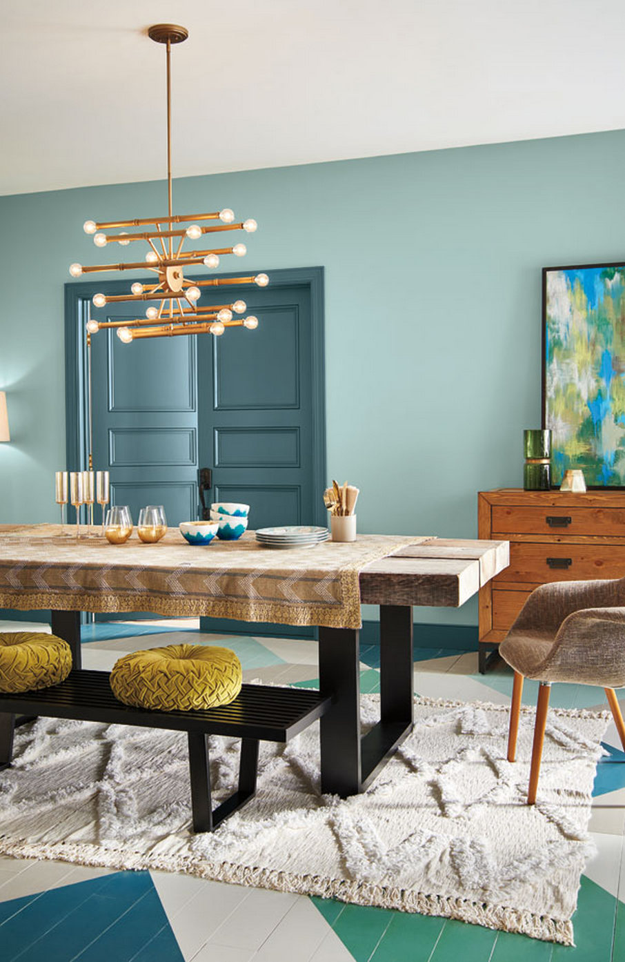 Soft Aqua Walls Are Layered With Deep Blue Green Trim Modern Furnishings And Sparkling Gold Accents Living Room